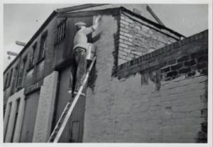 Re-painting following an air raid on Cardiff in 1941